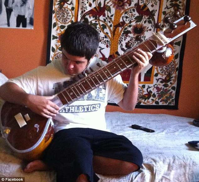 Comedian: The 17-year-old student from Florida relaxes with his sitar. He was dared to Tebow the faculty at his high school graduation ceremony for five dollars