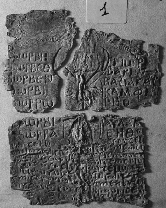 The tablet calls a snake-shrouded devil-goddess to 'bind' a mummified man - the victim is named as 'Porcellus'