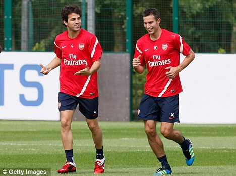 Don't do what I did: Cesc Fabregas has told Robin Van Persie to stay at Arsenal