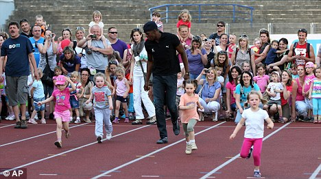 Nice touch: Bolt 'races' some children in Ostrava on Wednesday