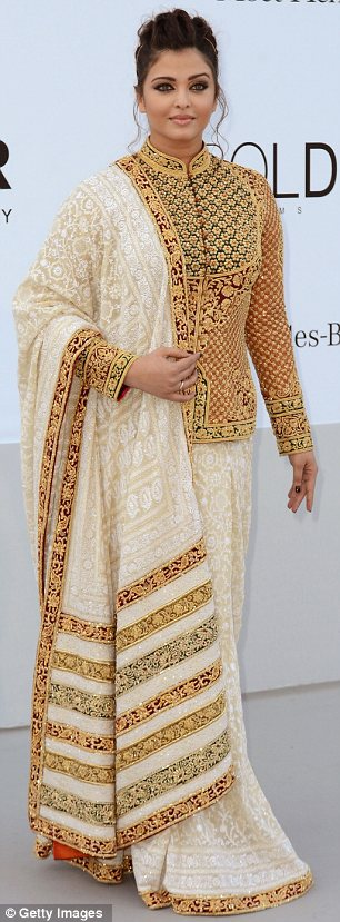 Star turn: Baby weight or not, Aishwarya looked every inch the Bollywood beauty in a gold embroidered sari and co-ordinating tailored jacket with Mandarin collar at the AmfAR Cinema Against Aids gala on Thursday night