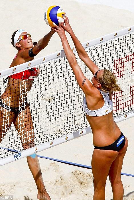 Germany's Ilka Semmler  is blocked by opponent Sanne Keizer of the Netherlands