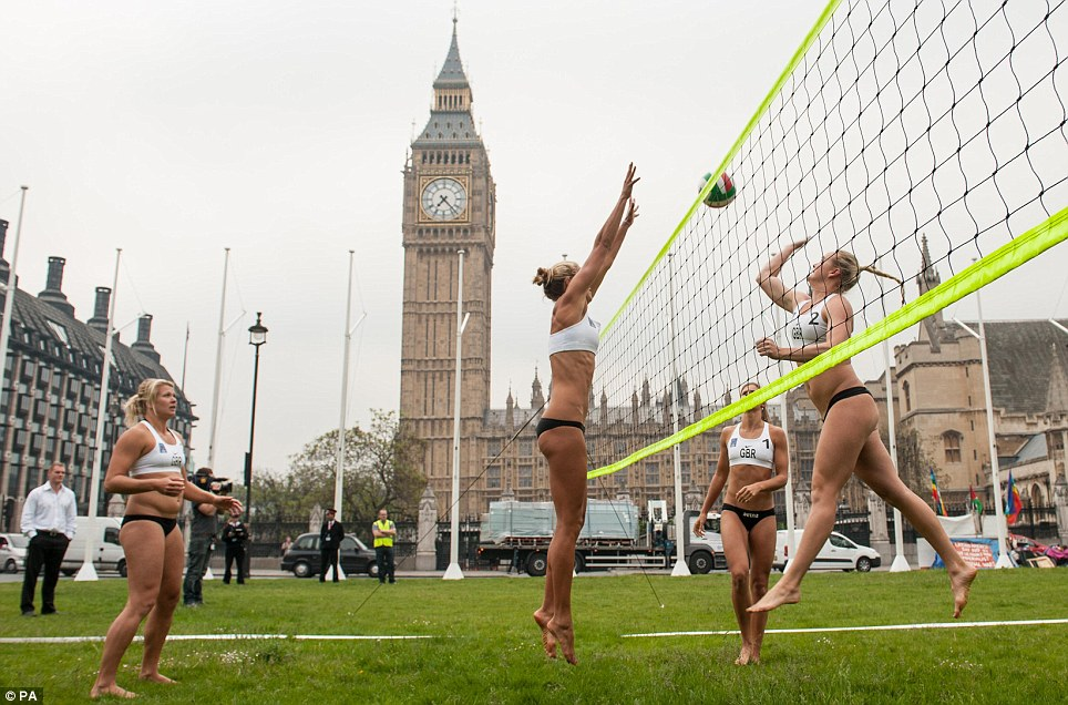Stopping traffic: The British beach volleyball team managed just that yesterday as they played a game against the backdrop of the Houses of Parliament