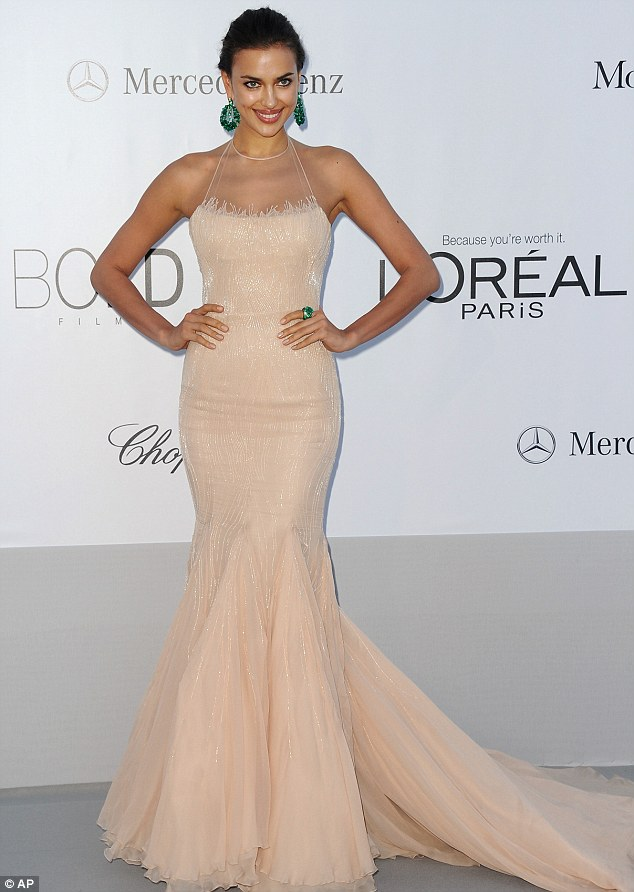 Simply stunning: Irina Shark wore a blush pink gown with bright green jewels to the event, held at the Hotel du Cap