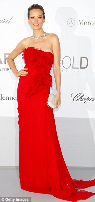 Ladies in red: Kylie Minogue took the plunge in a revealing gown, while model Petra Nemcova looked elegant in a strapless dress