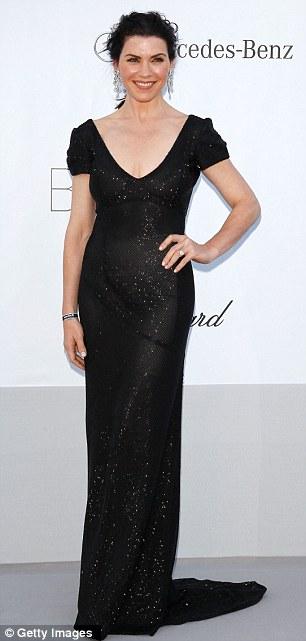 Sleek: former French Vogue editor Carine Roitfeld (left) and actress Julianna Margulies both chose sleek black gowns