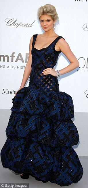 Dramatic: Kate Upton wore a black and blue gown with a puffball skirt, while Janet Jackson was sleek in white