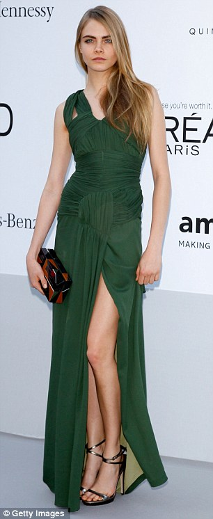 Colourful: Kirsten Dunst wore an blue and aquamarine gown, while Cara Delevigne looked glamorous in green