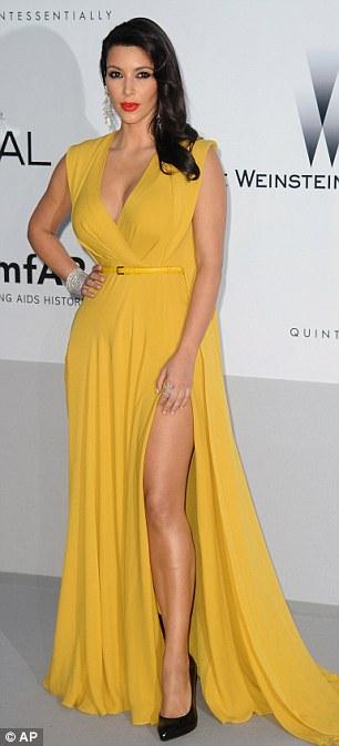 Colourful: Kim Kardashian and Joely Richardson celebrated summer in bright dresses
