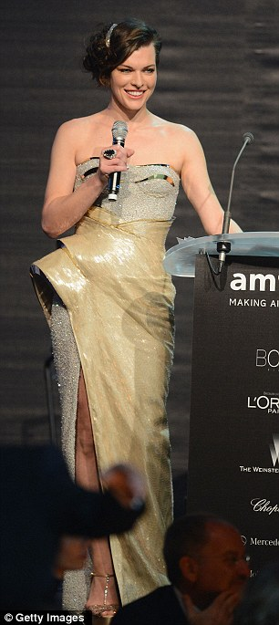 Model moment: Milla Jovovich and Kylie Minogue address the audience during the auction