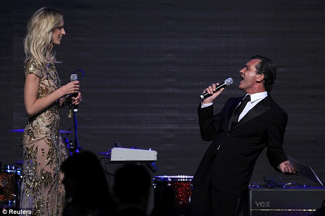 Karaoke? Karolina Kurkova and Antonia Banderas take to the stage