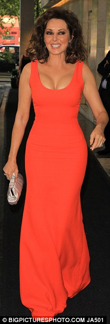 Great look: Carol Vorderman looked amazing in a tight red dress at The British Inspiration Awards, tonight