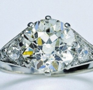 Right: Her platinum and diamond engagement ring from Prince Philip was made using stones from a tiara that had belonged to his mother, Princess Alice of Greece