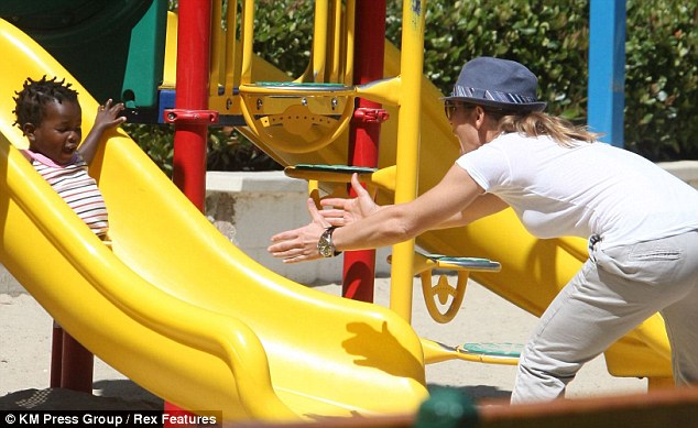 Mum's got you! Celebrity fitness trainer Jillian Michaels reassured newly adopted daughter, Lukensia, that she's safe in her arms while playing in a Malibu park Wednesday