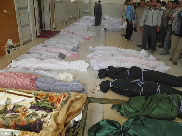 'Massacre': Bodies of those killed by Syrian forces in the atrocity are lined up in Houla