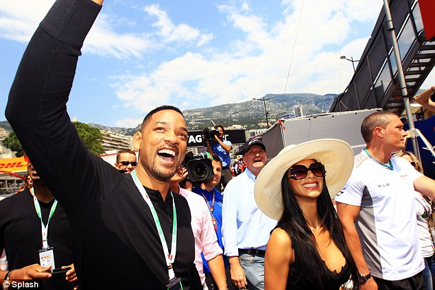 Man in black: Actor Will Smith and Nicole Scherzinger attend qualifying