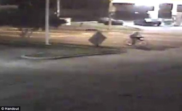 Same location: Visible in the top right of the video grab is Miss Shunick seen riding her bike home in the same area and time the three vehicles were seen passing