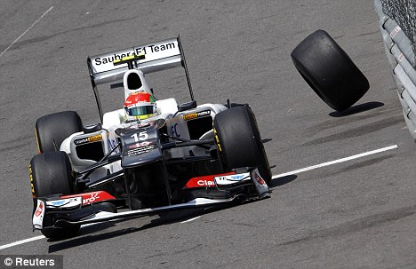 Wheely bad: Perez loses a tyre in qualifying after hitting the barrier