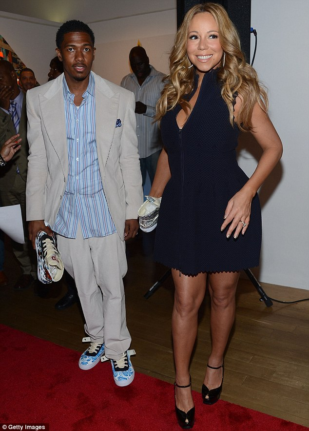Proud parents: Nick Cannon and Mariah, seen here at the Project Canvas Charity Event, threw a lavish birthday party for their twins at the Plaza Athenee in Paris last month