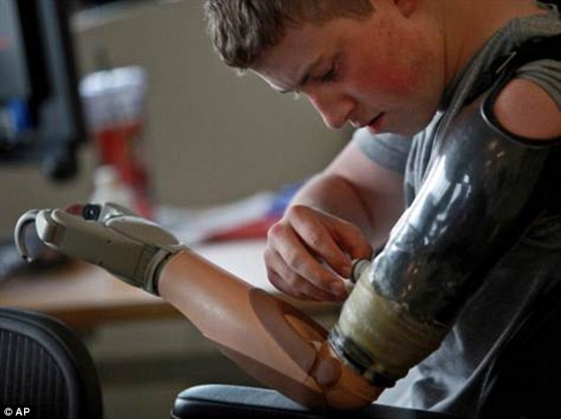 Injured: Kevin Trimble, 19, pictured lost both legs above the knee and an arm from a bomb in Afghanistan
