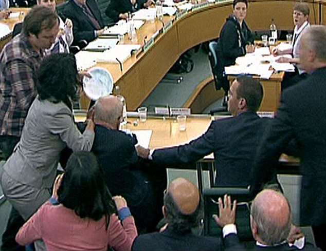 Echoes: The interruption was an embarrassing echo of the 'custard pie' incident when Rupert Murdoch was attacked during a Commons Select Committee last year and his wife, Wendi Deng, leapt to his defence and slapped the attacker