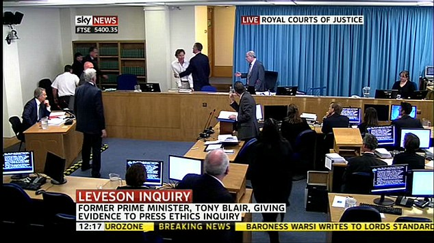 Embarrassing: David Lawley-Wakelin, dressed in a white shirt and chinos, then shouted to the stunned court, 'This man should be arrested for war crimes'