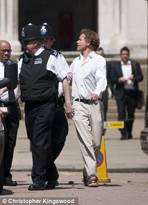 The man told reporters his name was David Lawley-Wakelin and he was from the Alternative Iraq Enquiry, He spoke as security guards escorted him through the Royal Courts of Justice.