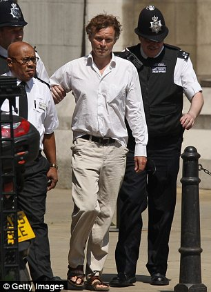 A protester, named as Wakelin, who disrupted former Prime Minister Tony Blair's testimony at the Leveson Inquiry, by bursting into the courtroom, is led away from the Royal Courts of Justice