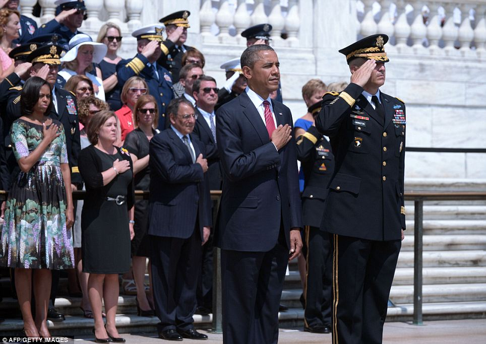 Hand on heart: President Obama stands next to Major General Michael Linnington, with First Lady Michelle Obama and Secretary of Defense Leon Panetta during the service at Arlington National Cemetery Monday morning