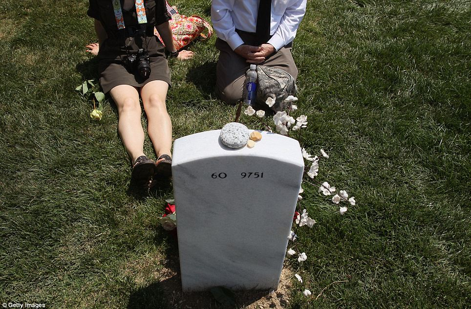 Mourning: Two people stop and reflect at a grave of an Iraq War veteran in Section 60