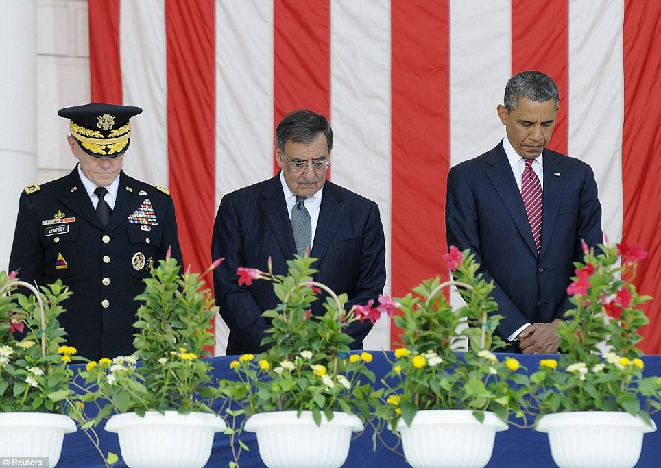 Showing respect: Chairman of the Joint Chiefs General Martin Dempsey (left), Defense Secretary Leon Panetta (center) President Barack Obama (right) during a prayer at the Arlington service