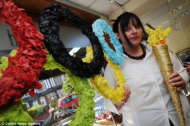 Burning the flame: Lisa Cross has until Wednesday to take down the display in Stoke-on-Trent when the torch relay will arrive in the city