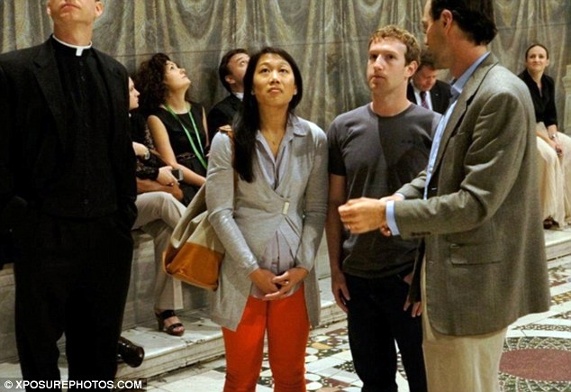 Roman holiday: Mark Zuckerberg and new wife Priscilla Chan look engrossed as a tour guide speaks about the Sistine Chapel on their honeymoon