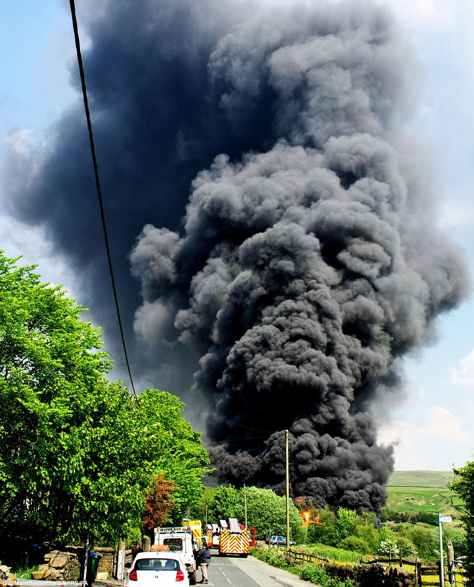 Explosion: A thick plume of black smoke rose from the fire