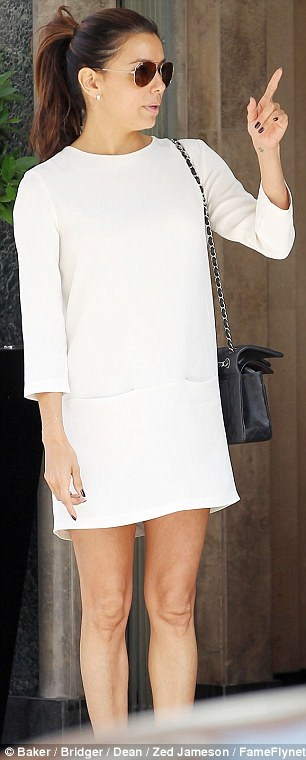 Natural beauty: Eva paired her minimalist dress with some simple sandals and a Chanel bag and went make-up free for the outing