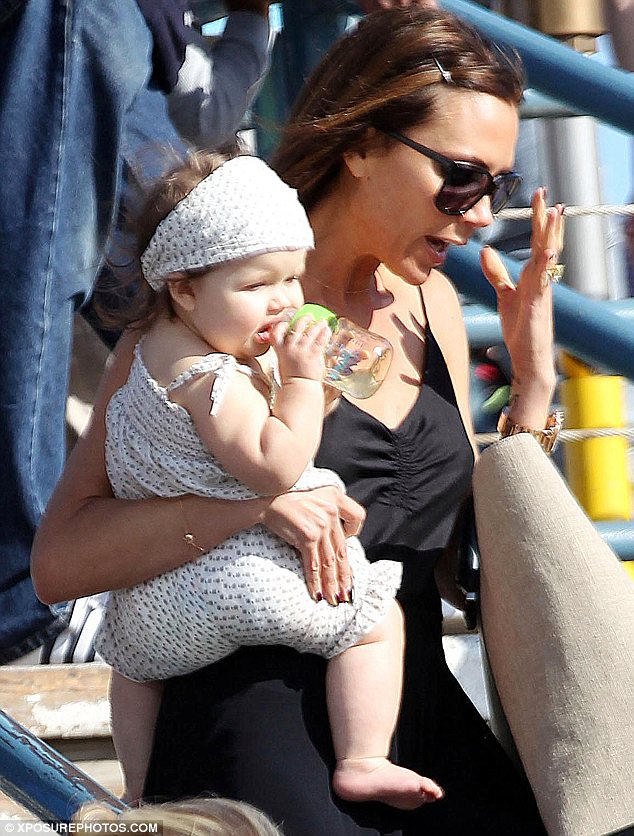 All the fun of the fair: Victoria Beckham took son Romeo and baby daughter Harper to Santa Monica pier