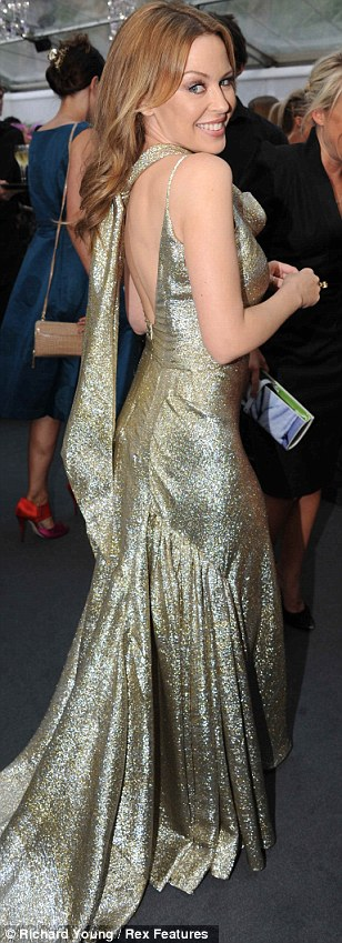 Glittering away: Kylie Minogue made quite an impact on the Glamour Awards red carpet this evening in a sparkling gold dress