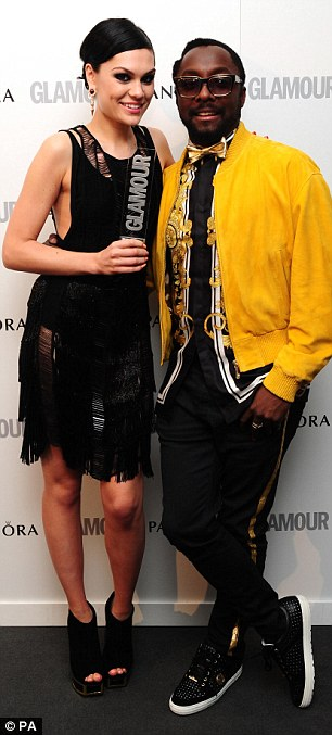 Best Solo Artist: Jessie J holds up her award with pride as she also posed with The Voice co-star Will.i.am who presented her with the accolade