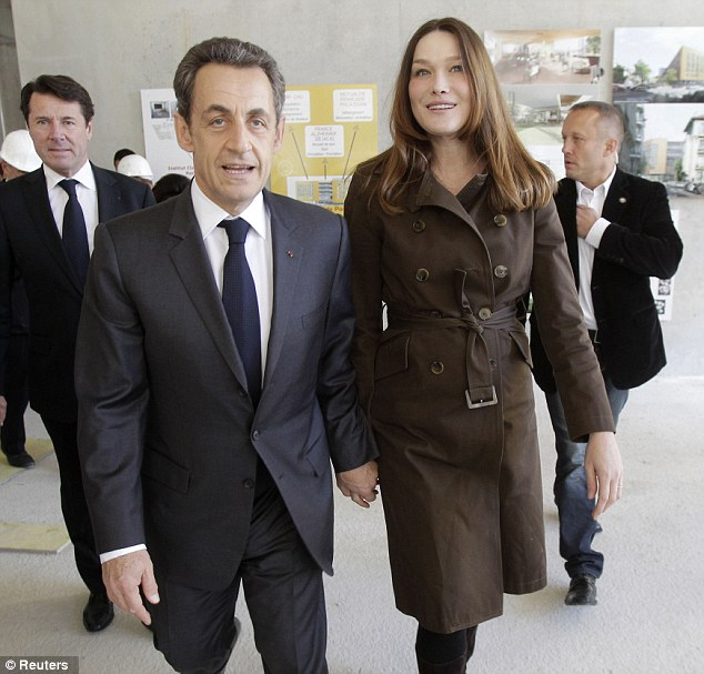 Big brother: Olivier is the younger half-brother of former French president Nicolas Sarkozy, pictured with his wife Carla Bruni
