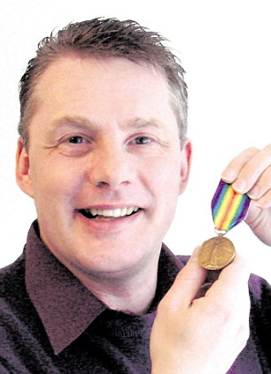 Reunited: Martin Robson Riley with his grandfather's World War One Medal that vanished 30 years ago