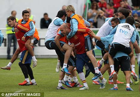Hot favourites: Spain are the reigning champions