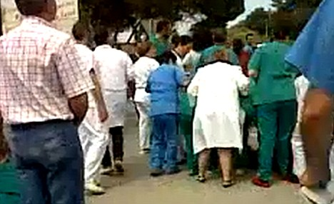 Worried: Crowds of doctors and nurses rushed to help their injured colleagues