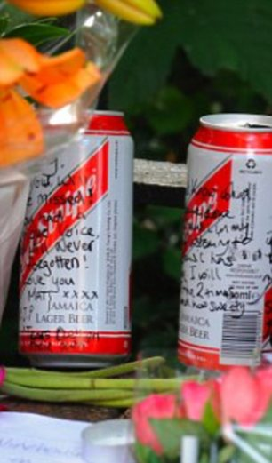 Remembering her in their own way: Some fans left alcohol while others left street art on the signs