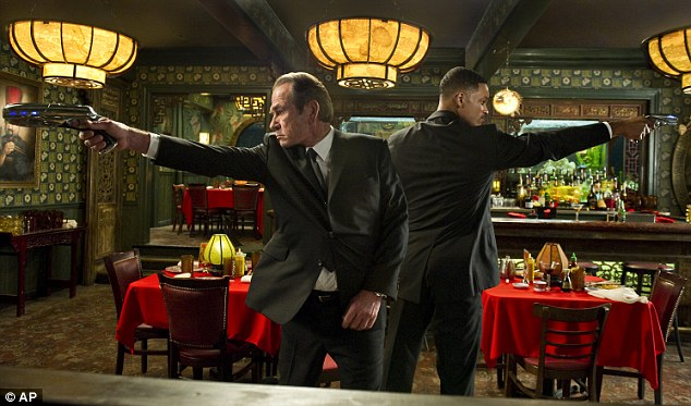 Secret agents: Tommy Lee Jones, left, and Will Smith do some of their alien hunting in New York's Chinatown - a fact which caused offence on the other side of the world