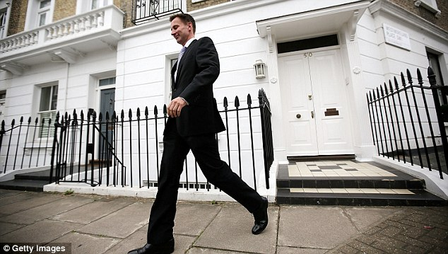 L-Day: Culture Secretary Jeremy Hunt trots out of his London house to go to the Leveson Inquiry this morning