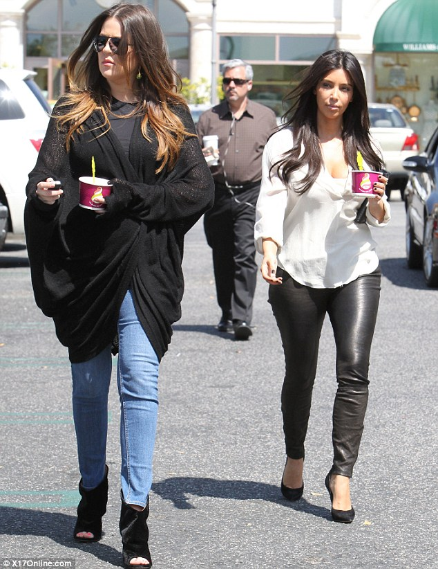 Out and about: Kim and sister Khloe were seen picking up ice-cream after a trip to Aquarium city in Studio City