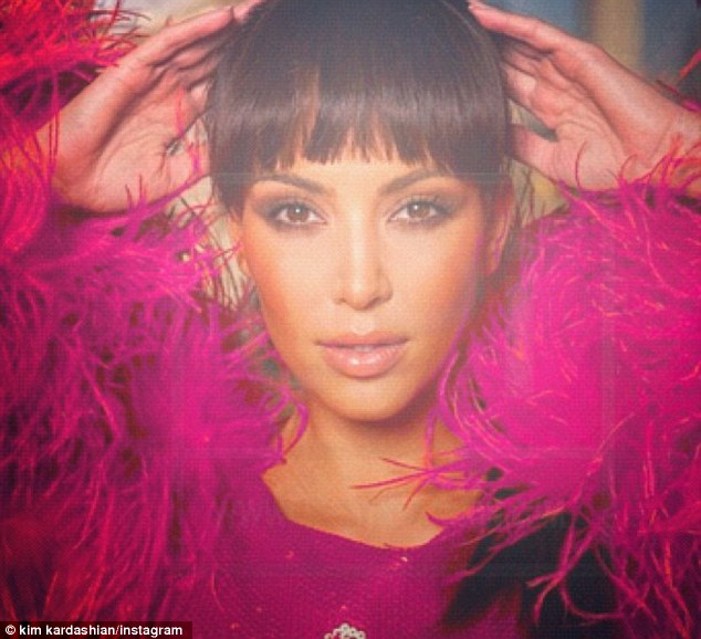 In the pink: Kim also shared an old picture of herself, saying she's 'obsessed' with the colour pink at the moment