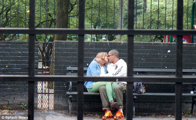 Eric Arty, 18, and Warning were snapped on a park bench in Greenwich Village next to a children's playground