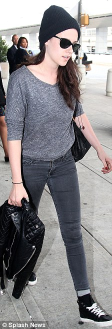 Dressed down: Kristen went for a more casual look as she arrived in New York earlier in the day