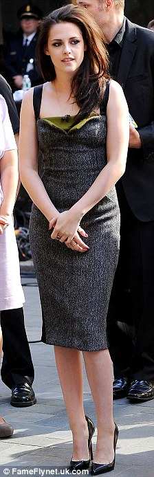 Slender: The actress showed off her slim figure in a green and grey dress for the outing